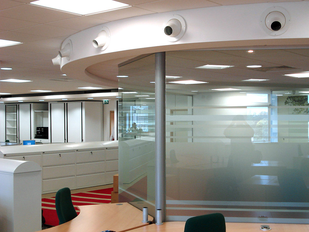 glazed walls, suspended ceilings and featured curved bulkheads
